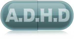 An illustration of a medicine capsule with the letters ADHD written on it.