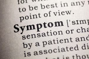 "A photograph of the word ""Symptom"" in the dictionary"